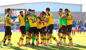 Mark Sykes (third right) celebrates with his Oxford team-mates after Cameron Brannagan's penalty sent his side into the League One play-off final.