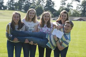 A Level student's at  Banbridge academy, Co Down celebrate getting their results. Pictured are A star students Lily spence, Jane Boyd,Zoe Burke and Mark Turkington with Simone Jackson. Picture Mark Marlow