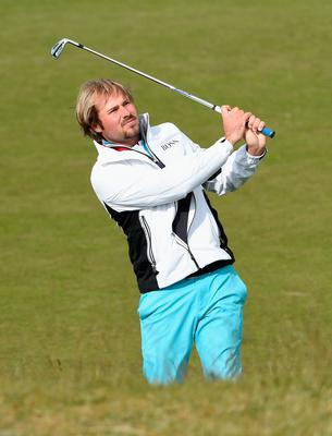 NEWCASTLE, NORTHERN IRELAND - MAY 29:  Victor Dubuisson of France hits his 2nd shot on the 13th hole during the Second Round of the Dubai Duty Free Irish Open Hosted by the Rory Foundation at Royal County Down Golf Club on May 29, 2015 in Newcastle, Northern Ireland.  (Photo by Ross Kinnaird/Getty Images)