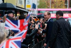 The Duke of Cambridge talks to wellwishers after his during a visit  to Inspire, a charity and social enterprise which focuses on promoting wellbeing for all across the island of Ireland, as part of his tour of Belfast. PRESS ASSOCIATION Photo. Picture date: Wednesday October 4, 2017. Niall Carson/PA Wire