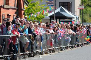 Crowds wait for the arrival of the Prince of Wales and Duchess of Cornwall at  Dromore Village in County Down, during their visit to Northern Ireland. Niall Carson/PA Wire