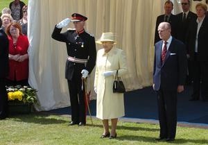 Alan Lewis - Photopress Belfast    1/5/07 Picture by Justin Kernoghan The Queen meeting guests at a Garden Party in the grounds of Coleraine University on her visit Northern Ireland this afternoon. The Queen and Prince Philip attended a garden party, at the University of Ulster in Coleraine - hosted by Northern Ireland Secretary Peter Hain. It was being held in recognition of the work of the community and voluntary sector.