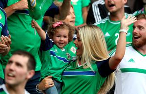 Helen McConnell and daughter Lottie, wife and daughter of Northern Ireland's Jonny Evans in the stands before the UEFA Euro 2016, Group C match at the Parc Des Princes, Paris. PRESS ASSOCIATION Photo. Picture date: Tuesday June 21, 2016. See PA story SOCCER N Ireland. Photo credit should read: Owen Humphreys/PA Wire. RESTRICTIONS: Use subject to restrictions. Editorial use only. Book and magazine sales permitted providing not solely devoted to any one team/player/match. No commercial use. Call +44 (0)1158 447447 for further information.