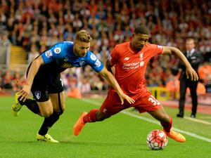 Bournemouth's English defender Simon Francis (L) challenges Liverpool's English midfielder Jordon Ibe during the English Premier League football match between Liverpool and Bournemouth at the Anfield stadium in Liverpool, north-west England on August 17, 2015. AFP PHOTO / OLI SCARFF  RESTRICTED TO EDITORIAL USE. No use with unauthorized audio, video, data, fixture lists, club/league logos or 'live' services. Online in-match use limited to 75 images, no video emulation. No use in betting, games or single club/league/player publications.OLI SCARFF/AFP/Getty Images
