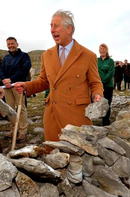 The Prince of Wales as he helps build a dry stone wall during his visit to the Burren in County Clare, an ancient and dramatic stony outcrop famed for its rare plant life, biodiversity and archaeology on on the first day of his Royal visit to the Republic of Ireland. PRESS ASSOCIATION Photo. Picture date: Tuesday May 19, 2015. See PA story ROYAL Ireland. Photo credit should read: John Stillwell/PA Wire