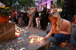 Mourners view tributes in St Ann's Square, Manchester (Jonathan Brady/PA)