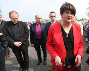 Press Eye - Belfast - Northern Ireland - 19th April 2019 -  Photo by Lorcan Doherty  / Press Eye.  The community vigil held on Fanad Drive, Creggan, following the murder of 29 years-old Lyra McKee.  DUP leader Arlene Foster arrives with party colleagues Gary Middleton and Gregory Campbell. Included are Fr. Joe Gormley and Bishop Ken Good.