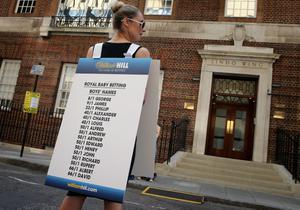 A girl from a Betting Company wears a board highlighting the latest odds on babies names outside the Lindo wing of St Mary's Hospital as the UK prepares for the birth of the first child of The Duke and Duchess of Cambridge. (Photo by Chris Jackson/Getty Images)