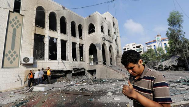 Palestinians inspect the damage at the Ameen mosque in Gaza City, northern Gaza Strip, destroyed by an Israeli strike, Tuesday, July 29, 2014.  (AP Photo/Lefteris Pitarakis)