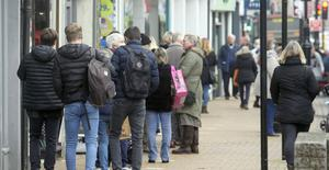 People queued outside shops as retailers reopened after England's second national lockdown (Steve Parsons/PA)