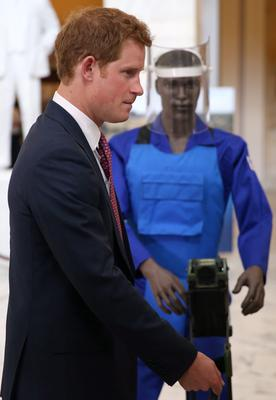 WASHINGTON, DC - MAY 09:  HRH Prince Harry tours an anti-landmine photography exhibition by The HALO Trust charity during the first day of his visit to the United States at the Russell Senate Office Building on May 9, 2013 in Washington, DC. HRH will be undertaking engagements on behalf of charities with which the Prince is closely associated on behalf also of HM Government, with a central theme of supporting injured service personnel from the UK and US forces.  (Photo by Chris Jackson-Pool/Getty Images)