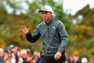 NEWCASTLE, NORTHERN IRELAND - MAY 30:  Rickie Fowler of the United States reacts to an eagle on the 16th hole during the Third Round of the Dubai Duty Free Irish Open Hosted by the Rory Foundation at Royal County Down Golf Club on May 30, 2015 in Newcastle, Northern Ireland.  (Photo by Ross Kinnaird/Getty Images)
