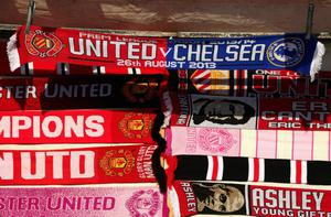 MANCHESTER, ENGLAND - AUGUST 26:  General View of scarves on sale prior to the Barclays Premier League match between Manchester United and Chelsea at Old Trafford on August 26, 2013 in Manchester, England.  (Photo by Alex Livesey/Getty Images)