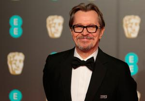 British actor Gary Oldman poses on the red carpet upon arrival at the BAFTA British Academy Film Awards at the Royal Albert Hall in London on February 18, 2018. / AFP PHOTO / Daniel LEAL-OLIVASDANIEL LEAL-OLIVAS/AFP/Getty Images