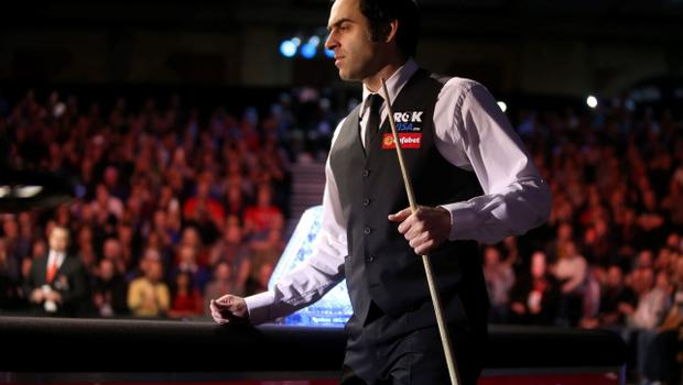 Ronnie O'Sullivan walks out for the start of the 2014 Dafabet Masters Final at Alexandra Palace, London. PRESS ASSOCIATION Photo. Picture date: Sunday January 19, 2014. See PA story SNOOKER Masters. Photo credit should read: John Walton/PA Wire