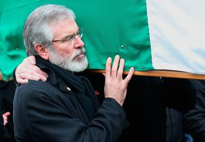 Gerry Adams carries the coffin during the funeral procession of Northern Ireland's former deputy first minister and ex-IRA commander Martin McGuinness, ahead of his funeral at St Columba's Church Long Tower, in Londonderry. Thomas McMullan/PA Wire