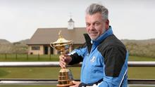 European Ryder Cup captain Darren Clarke and the Ryder Cup trophy pictured at Royal Portrush GC in Co. Antrim. Picture credit © Matt Mackey - Presseye.com  Belfast - Northern Ireland - 12th April 2016