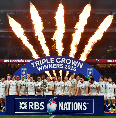 Blaze of glory: England players celebrate their Triple Crown success at Twickenham