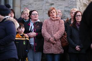 Members of the public at a vigil in the grounds of Holy Cross Church, Ardoyne. Photo by Kelvin Boyes / Press Eye