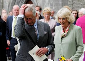 SLIGO, IRLEAND - MAY 20:  Prince Charle, Prince of Wales and Camilla, Duchess of Cornwall attend a ceremony to plant a London Oak tree after a service of peace and reconciliation at St. Columba's Church in Drumcliffe on the second day of a four day visit to Ireland on May 20, 2015 in Sligo, Ireland. The Prince of Wales and Duchess of Cornwall arrived in Ireland yesterday for their four day visit to the Republic and Northern Ireland, the visit has been described by the British Embassy as another important step in promoting peace and reconciliation.  (Photo by Brian Lawless - WPA Pool/Getty Images)