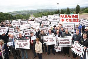 PACEMAKER BELFAST  04/09/2015 Farmers, processers and retailers have held a protest at Stormont to highlight volatility in prices. It was organised by the Ulster Farmers' Union (UFU) and comes ahead of Monday's key EU farm ministers summit on the crisis in the dairy industry. Farming Protestors wave their placards outside Stormont. Picture Matt Bohill.