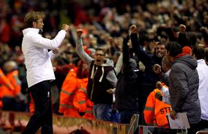 Liverpool manager Jurgen Klopp celebrates his side's first goal during the UEFA Europa League Quarter Final, Second Leg match at Anfield, Liverpool. PRESS ASSOCIATION Photo. Picture date: Thursday April 14, 2016. See PA story SOCCER Liverpool. Photo credit should read: Peter Byrne/PA Wire