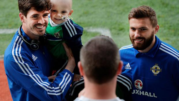 BELFAST, NORTHERN IRELAND - MAY 27: Northern Ireland's Kyle Lafferty (L) and Stuart Dallas (R) pose with fans before the international friendly game between Northern Ireland and Belarus on May 26, 2016 in Belfast, Northern Ireland. (Photo by Charles McQuillan/Getty Images)