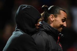 Manchester United's French midfielder Paul Pogba (L) hugs Manchester United's Swedish striker Zlatan Ibrahimovic (R) after the final whistle in the UEFA Europa League group A football match between Manchester United and Fenerbahce at Old Trafford in Manchester, north west England, on October 20, 2016. / AFP PHOTO / OLI SCARFFOLI SCARFF/AFP/Getty Images
