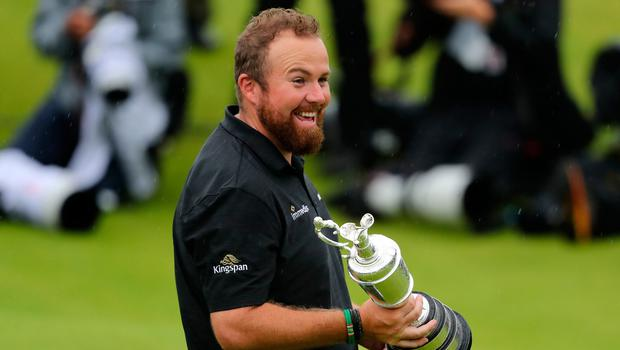 Shane Lowry finally gets his hands on the Claret Jug.