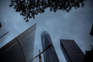 NEW YORK, NY - SEPTEMBER 11:  One World Trade Center is seen through early morning clouds on September 11, 2015 in New York City. Today marks the 14th anniversary of the attacks where nearly 3,000 people were killed in New York, Washington D.C. and Pennsylvania.  (Photo by Andrew Burton/Getty Images)