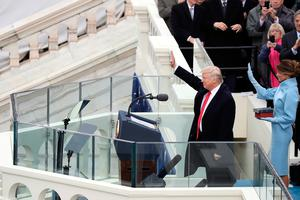 US President Donald Trump and his wife Melania Trump wave after he took the oath of office on the West Front of the U.S. Capitol on January 20, 2017 in Washington, DC. In today's inauguration ceremony Donald J. Trump becomes the 45th president of the United States.  (Photo by Drew Angerer/Getty Images)
