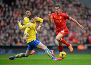LIVERPOOL, ENGLAND - FEBRUARY 08:  Jordan Henderson of Liverpool is challenged by Laurent Koscielny of Arsenal during the Barclays Premier League match between Liverpool and Arsenal at Anfield on February 8, 2014 in Liverpool, England.  (Photo by Michael Regan/Getty Images)
