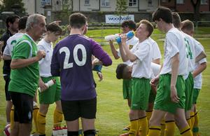 Donegal Schoolboys get in a team talk during a water break at Brooke Park on Tuesday in the Hughes Insurance Foyle Cup. C02-T2-04