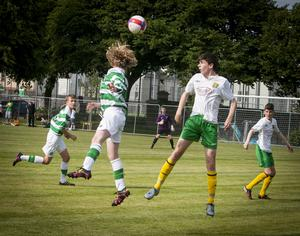 Celtic's Owen Moffatt and Donegal's Conor Black in an aerial tussle for possession during Tuesday evening's Hughes Insurance Foyle Cup game at Brooke Park, Derry. C02-T2-03