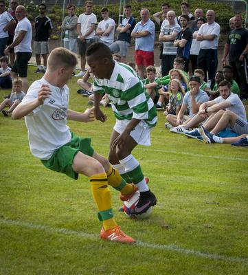 Donegal Schoolboys' Kieran Tobin gets in a telling tackle on Celtic's Karomoko Dembele during Tuesday evening's Hughes Insurance Foyle Cup game at Brooke Park, Derry. FC02-T2-02