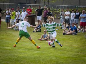 Celtic's diminutive winger Owen Moffatt attempts to get past Donegal Schoolboys' Kieran Tobin during Tuesday evening's Hughes Insurance Foyle Cup game at Brooke Park, Derry. FC02-T2-01