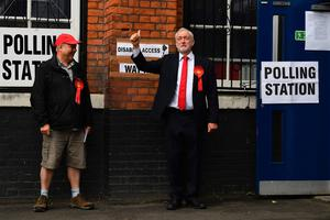 Britain's main opposition Labour Party leader Jeremy Corbyn arrives at a polling station to cast his vote in north London on June 8, 2017, as Britain holds a general election. As polling stations across Britain open on Thursday, opinion polls show the outcome of the general election could be a lot tighter than had been predicted when Prime Minister Theresa May announced the vote six weeks ago. / AFP PHOTO / Justin TALLISJUSTIN TALLIS/AFP/Getty Images