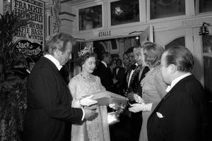 The Queen receiving a record album – extracts from 25 years of Royal Variety Performance – from Vera Lynn in 1973 (PA)