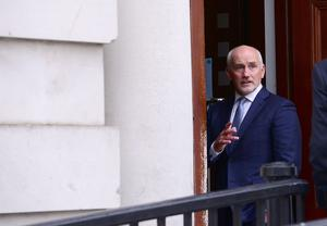 Boxing manager and former world champion, Barry McGuigan arrives at Belfast High Court this morning for his legal battle with Belfast boxer. Picture By: Arthur Allison/ Pacemaker Press