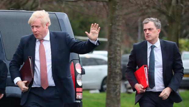 Prime Minister Boris Johnson (left) and Secretary of State for Northern Ireland, Julian Smith (right) during their visit to Stormont, Belfast. Liam McBurney/PA Wire