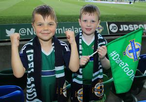 PressEye-Northern Ireland- 2nd June 2017-Picture by Brian Little/PressEye  James McGrath (7)  and Joshua Gray (7) from Bangor   supporting Northern Ireland against    New Zealand  during Friday night's Vauxhall  International at  the National Football Stadium, Windsor Park ,Belfast. Picture by Brian Little/PressEye