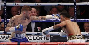 PACEMAKER BELFAST  28/02/2015 Carl Frampton v Chris Avalos World Title boxing at the Odyssey Arena. Carl Frampton lands shot on Chris Avalos during this evenings world title fight. Photo Aidan O'Reilly/Pacemaker Press