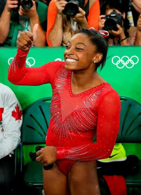 RIO DE JANEIRO, BRAZIL - AUGUST 14:  Simone Biles of the United States celebrates winning the gold medal in the Women's Vault Final on Day 9 of the Rio 2016 Olympic Games at the Rio Olympic Arena on August 14, 2016 in Rio de Janeiro, Brazil.  (Photo by Alex Livesey/Getty Images) *** BESTPIX ***