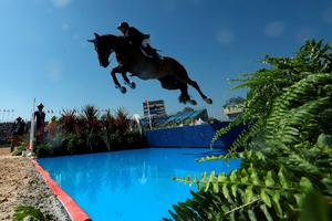 RIO DE JANEIRO, BRAZIL - AUGUST 14:  Scott Keach of Australia riding Fedor competes during the Jumping Individual and Team Qualifier on Day 9 of the Rio 2016 Olympic Games at the Olympic Equestrian Centre on August 14, 2016 in Rio de Janeiro, Brazil.  (Photo by Christian Petersen/Getty Images) *** BESTPIX ***