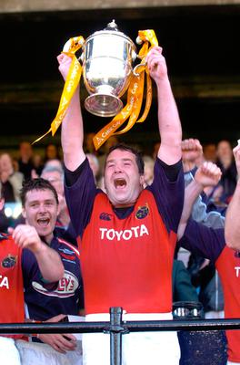 File photo dated 14-05-2005 of Munster captain Anthony Foley celebrates with the Celtic Cup after beating Llanelli Scarlets. PRESS ASSOCIATION Photo. Issue date: Sunday October 16, 2016. Munster head coach Anthony Foley has died at the team hotel in Paris before their European Champions Cup tie against Racing 92, the Irish club have announced. See PA story RUGBYU Foley. Photo credit should read Haydn West/PA Wire.
