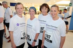 Press Eye - Belfast -  Northern Ireland - 24th June 2015 -  Diana Johnston, Attracta Maginnis, Ann George and Lisa Poland from First Trust at the first ever Grant Thornton Runway Run at Belfast City Airport this evening. Picture by Kelvin Boyes / Press Eye.