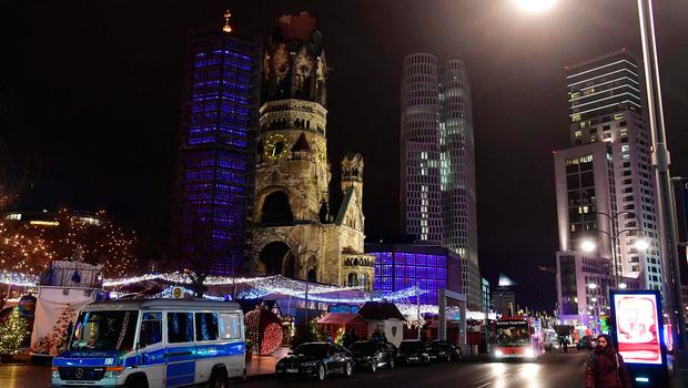 Police and firefighters are standing around the site next to the Gedächniskirche church (background) where a truck crashed into a christmas market in Berlin, on December 19, 2016 killing at least nine people and injuring at least 50 people. / AFP PHOTO / John MACDOUGALLJOHN MACDOUGALL/AFP/Getty Images