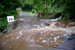 An entrance to a bed and breakfast property is block by rocks and debris from flash flooding in the coastal village of Coverack in Cornwall.  Ben Birchall/PA Wire