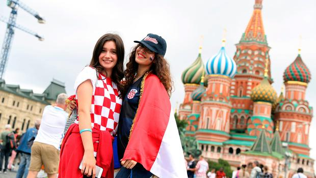 Croatia fans in Red Square ahead of the FIFA World Cup, Semi Final match at the Luzhniki Stadium, Moscow. PRESS ASSOCIATION Photo. Picture date: Wednesday July 11, 2018. See PA story WORLDCUP Croatia. Photo credit should read: Aaron Chown/PA Wire. RESTRICTIONS: Editorial use only. No commercial use. No use with any unofficial 3rd party logos. No manipulation of images. No video emulation.