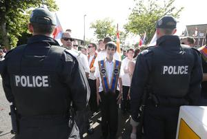 Press Eye - Belfast -  Saturday 20th July 2013   Protestors pictured at Ardoyne in Belfast afternoon attempt to parade up to the police lines.  In an unexpected move earlier this week, Orangemen made a new application to the Parades Commission adjudication body to march the disputed Crumlin Road section of the route today. That bid was again rejected by the commission - a move that is likely to prompt another stand-off between police and protesters at the same community interface area later.  The Order said it applied for Saturday's event to complete a return parade they were banned from making on the Twelfth of July.  Order members have continued to hold protests in the area throughout the week.  Picture by Kelvin Boyes / Press Eye.